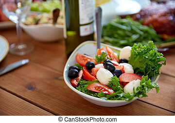 vegetable salad with mozzarella on wooden table
