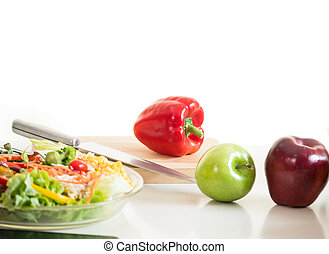 Vegetables and fruit on chopping board, food ingredient ready for cooking