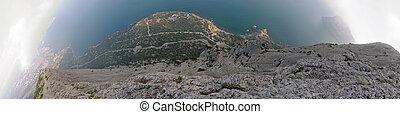 "Five shots 180 degrees panorama from ""Sokol"" Rock top in vertical down direction (""Novyj Svit"" reserve, Crimea, Ukraine)."