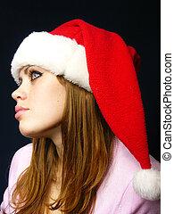beautiful girl in a New Year's cap