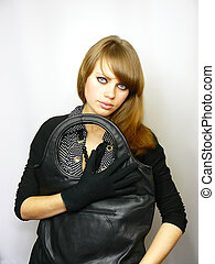 beautiful young girl with a black leather bag