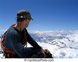 Mountaineer absorbing the view from the top of Großvenediger in the Austrian Alps