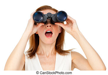 Visionary businesswoman looking through binoculars against a white background