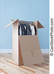Wardrobe box with clothing, ready for moving