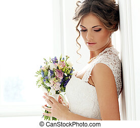 Wedding. Beautiful bride with bouquet