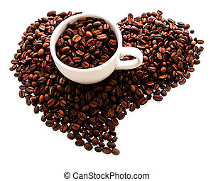 white cup with roasted coffee beans in the shape of the heart isolted on white background.