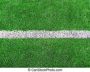 White stripe on the green soccer fi