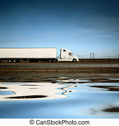 White truck on the road under blue sky