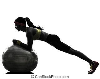 one woman exercising plank position on fitness ball in silhouette on white background