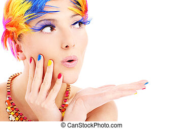 A portrait of a happy woman in a colorful makeup posing over white background