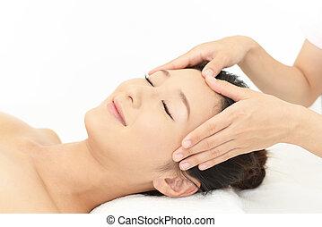 Woman getting a facial massage
