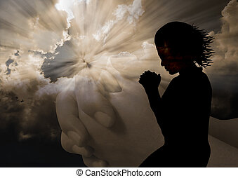 Woman kneel praying in silhouette