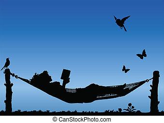 Woman Reading in a Hammock against a blue sky
