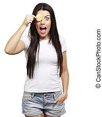 woman with a potatoe chip