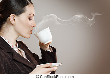 Woman with an aromatic coffee in hands