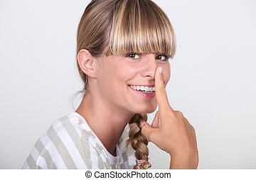 Woman with finger on her nose