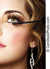 woman with long eyelashes and mascara