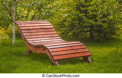 wooden bench on a lawn with green grass