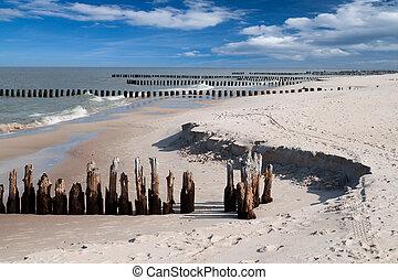 Wooden breakwaters at Baltic sea coast.