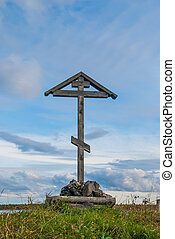 Wooden orthodox cross against a bright sky