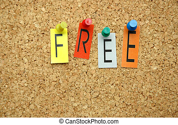 """Word """"Free """" placed from colourful small letters on the cork board"""