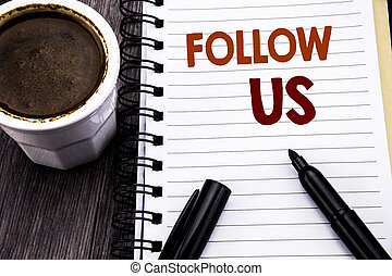 Writing text showing Follow Us. Business concept for Social Media Marketing written on notebook book note paper on the wooden wood background. With coffee and black marker.
