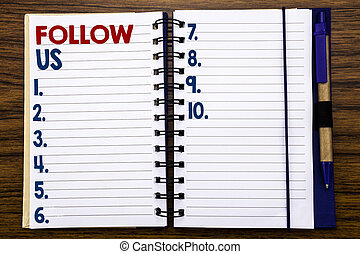 Writing text showing Follow Us. Business concept for Social Media Marketing Written on notebook note paper, wooden background with pen and marker.