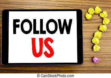 Writing text showing Follow Us. Business concept for Social Media Marketing written on tablet computer on the wooden background with question mark made of folded paper.