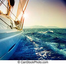 Yacht Sailing against sunset. Sailboat. Sepia toned