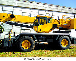 Yellow machinery truck picture