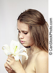 young and beautiful girl model with a white lily
