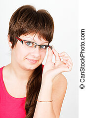 Young attractive blue-eyed girl in glasses