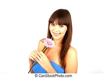 young beautiful brunette woman with a flower happy