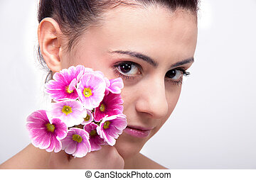 young beautiful brunette woman with flower
