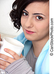 young beautiful girl with a cup of coffee