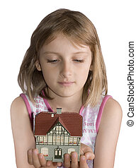 Young beautiful girl with house in hand