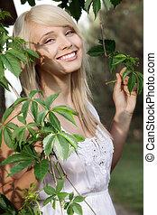 Young beautiful women in plants