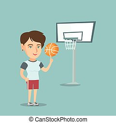 Young caucasian basketball player spinning a ball.