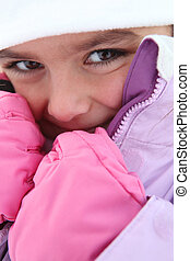 Young girl in a snowsuit