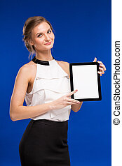 young girl in a white blouse with tablet in hand
