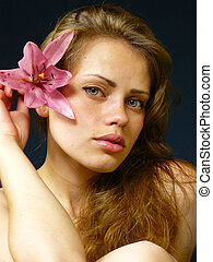young girl with a lily in hairs