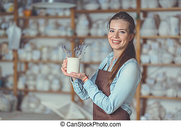 Young girl with a vase in pottery