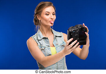 young girl with camera in hand