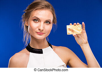 Young girl with credit card in hands