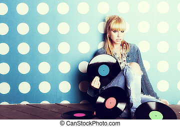 Young girl with vinyl records in the hands