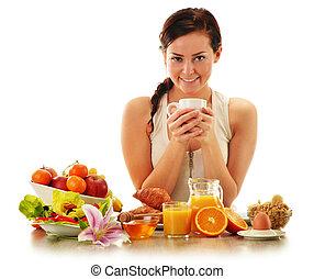 Young woman having breakfast. Balanced diet