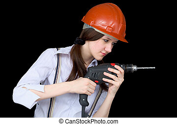 Young woman in a protective helmet with a drill