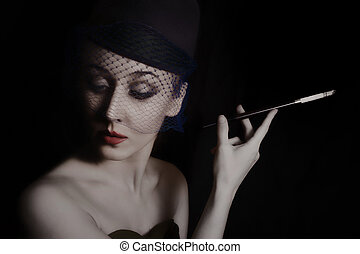 young woman in veil with cigarette