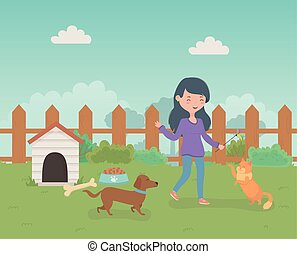 young woman with cute little dog and cat mascots in the field
