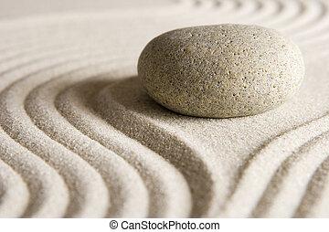 Stone on raked sand; mini rock garden; Zen concept